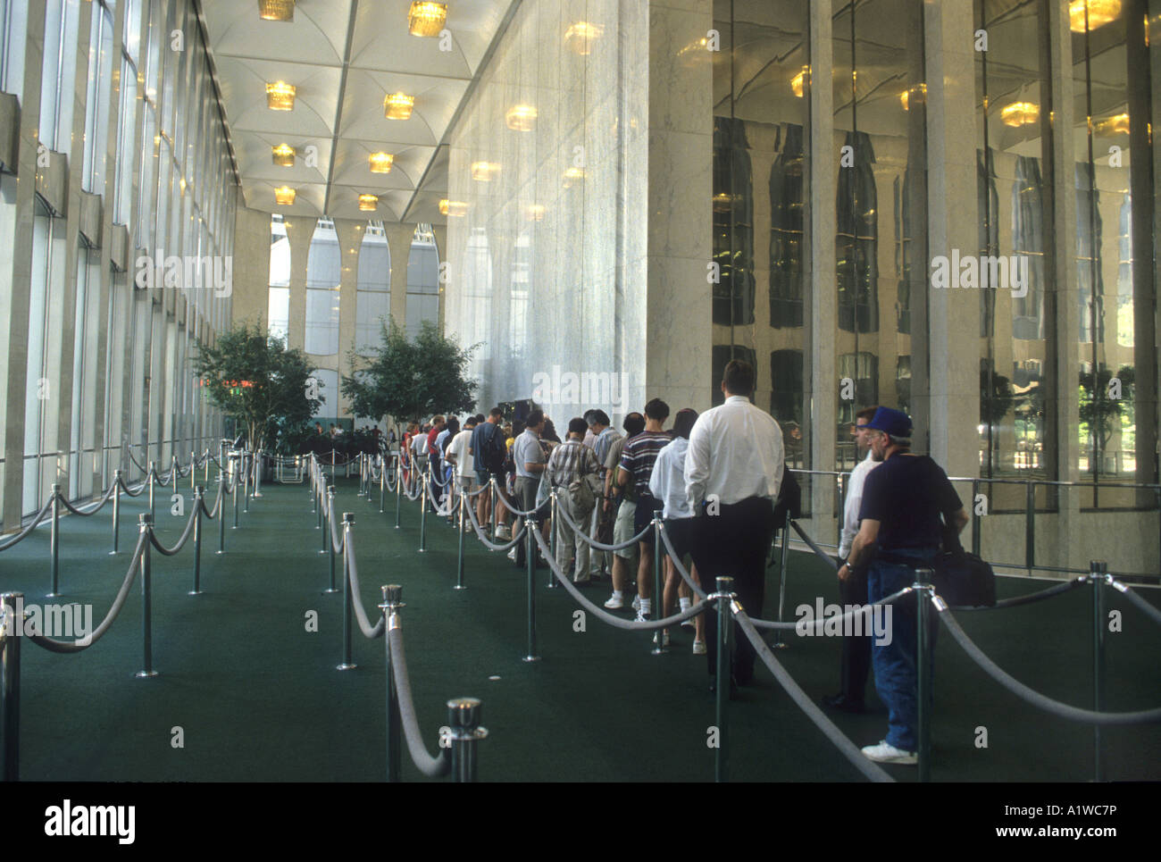 People Queing In A Line,To Go Up One Of The World Trade Center Skyscrapers. That Were In Manhattan NYC.Pre 9/11. - Stock Image