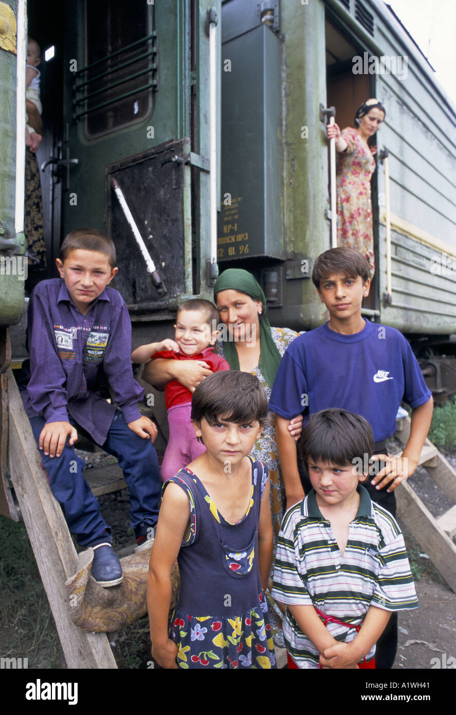 LEILA AND HER FAMILY OUTSIDE THE REFUGEE TRAIN WHERE 5000 CHECHEN REFUGEES LIVE. NASRAN INGUSHETIA 2000 - Stock Image