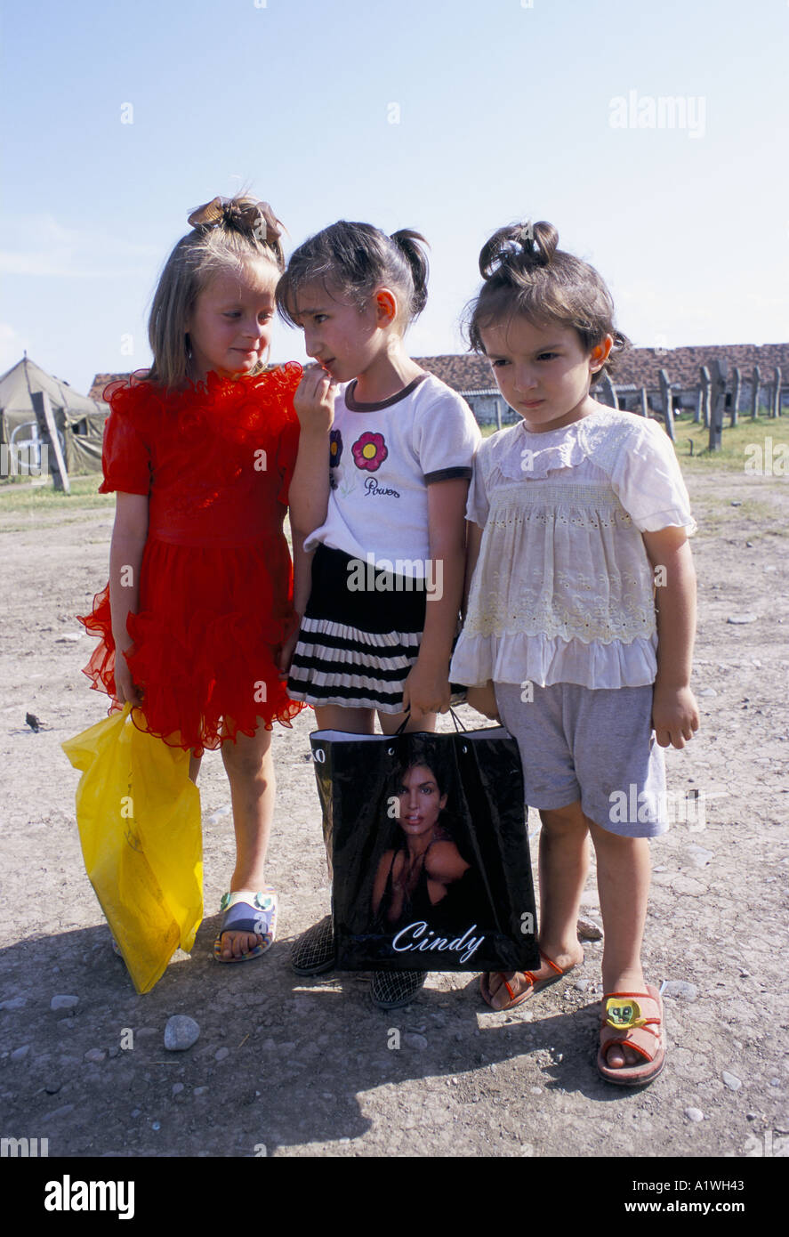 ZURA,DIANA AND ZAIRA,Chechen girls displaced by the war,  Diana holds a carrier bag with Cindy Crawford on it. - Stock Image