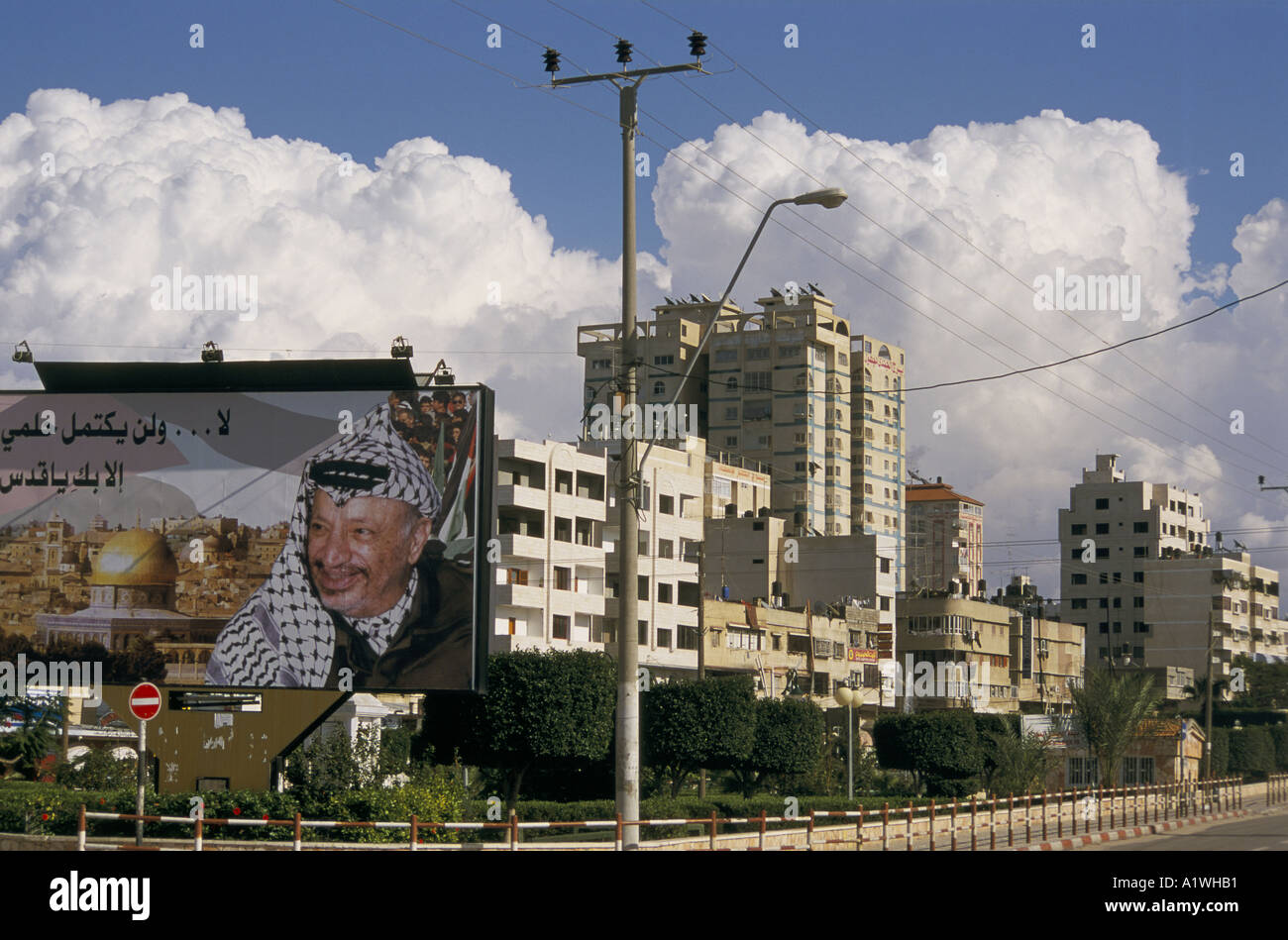 Large poster showing YASSER ARAFAT and Al Aqsa mosque with city buildings behind.2000 - Stock Image