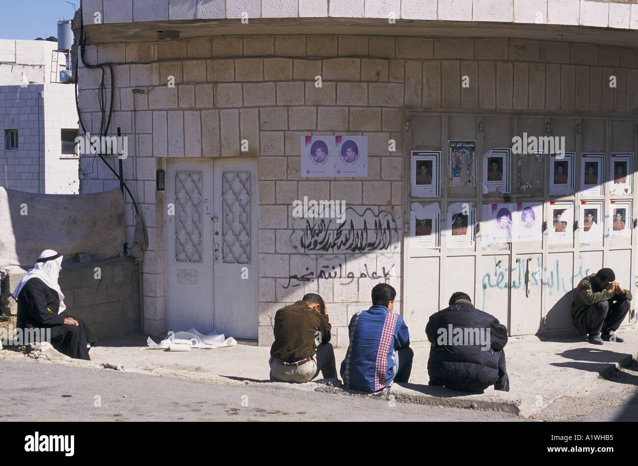 UNEMPLOYED MEN IN RAMALLAH.WORKERS CANNOT TRAVEL TO ISRAEL BECAUSE THE EREZ BORDER HAS BEEN SHUT  2000 - Stock Image