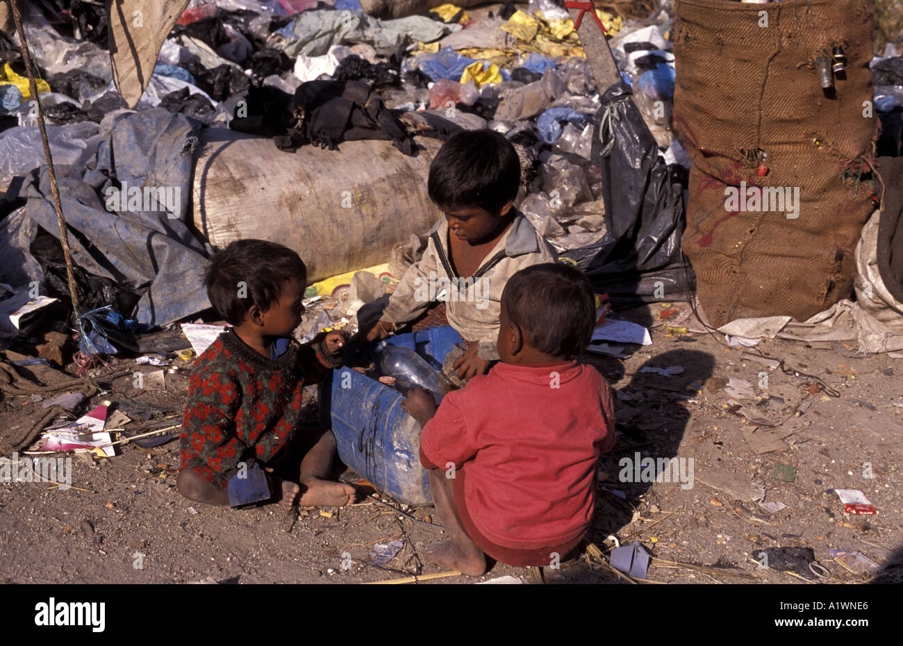 Children sort rubbish to sell ,Kathamndu Nepal - Stock Image