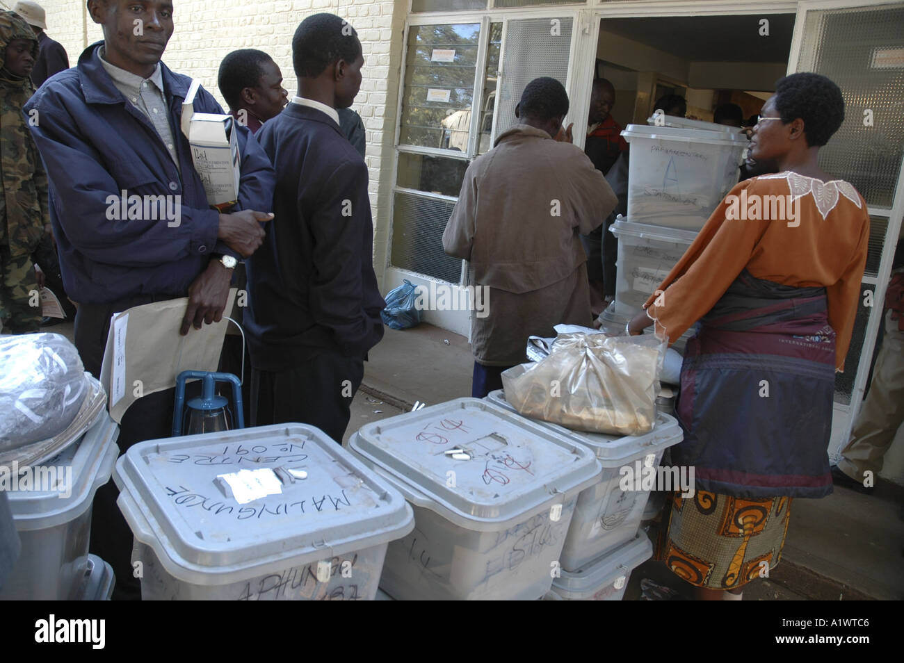 Officials deliver boxes of votes cast in Malawi election yesterday 20th of May 2004 - Stock Image