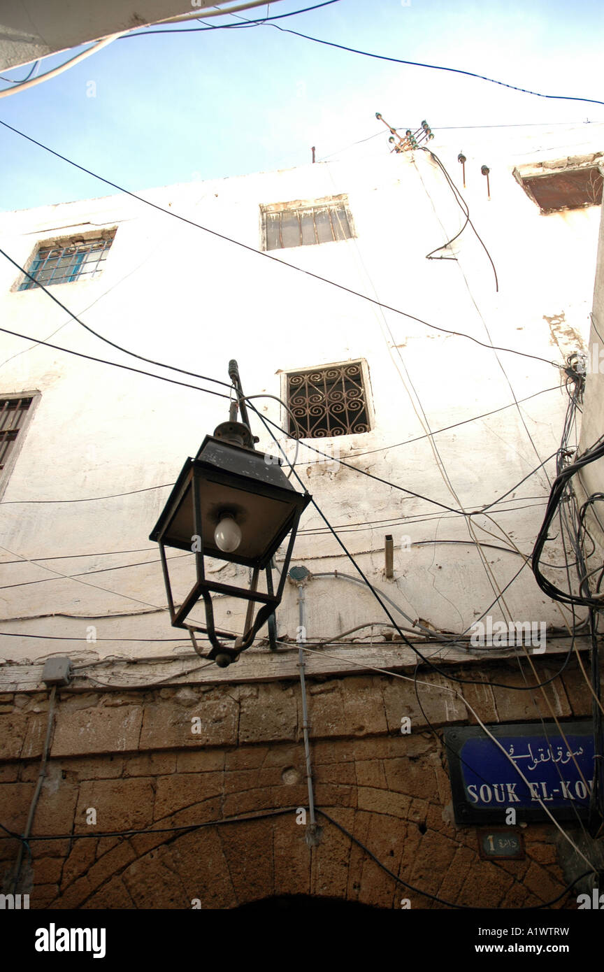 Building wall and lamp with many wires in Tunis medina, capital of ...