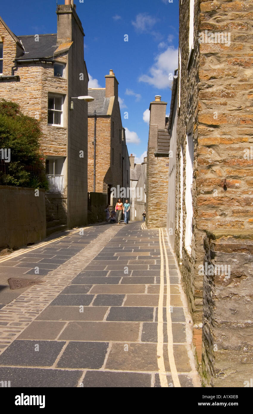 dh Dundas Street STROMNESS ORKNEY Houses cobbled and Orkney slate slabbed street people cobble stroll slab Stock Photo