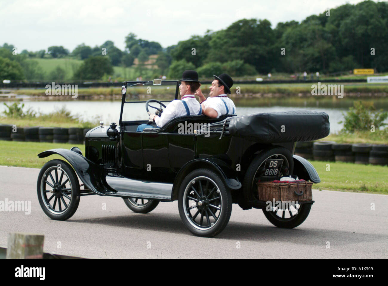 laurel and hardy look alike driving a classic ford car comedy duo actor film black and white star - Stock Image