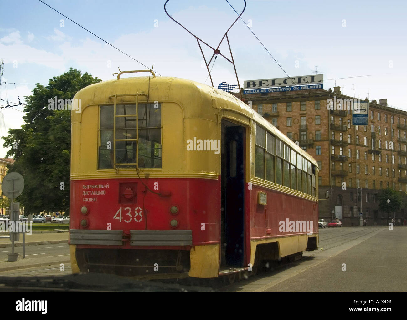 Electric pre-war tram with Fischer bow collector on roof in motion on city street in Minsk capital city of Belarus - Stock Image