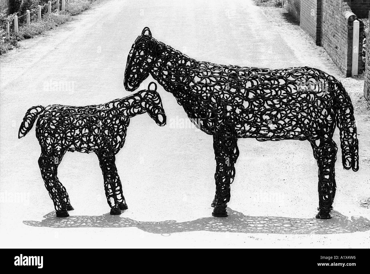 Lifesize model mare and foal made from horseshoes at Heydon in Norfolk UK - Stock Image