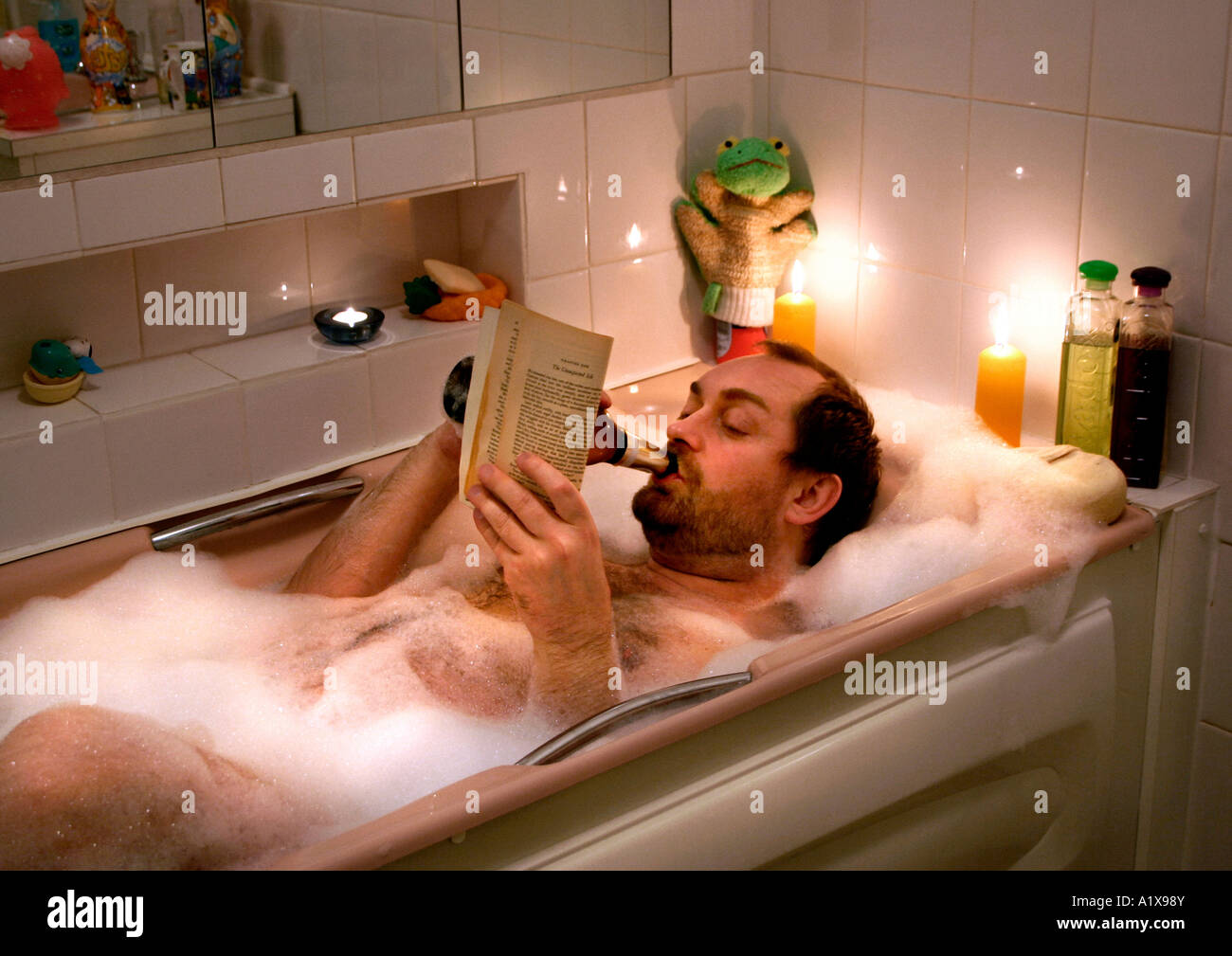 Taking A Bath While Reading Stock Photos & Taking A Bath While ...