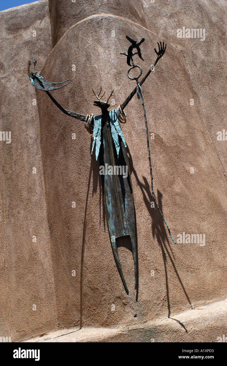 A Spindly Human Figure Like Sculpture With A Hart Head Its Arms