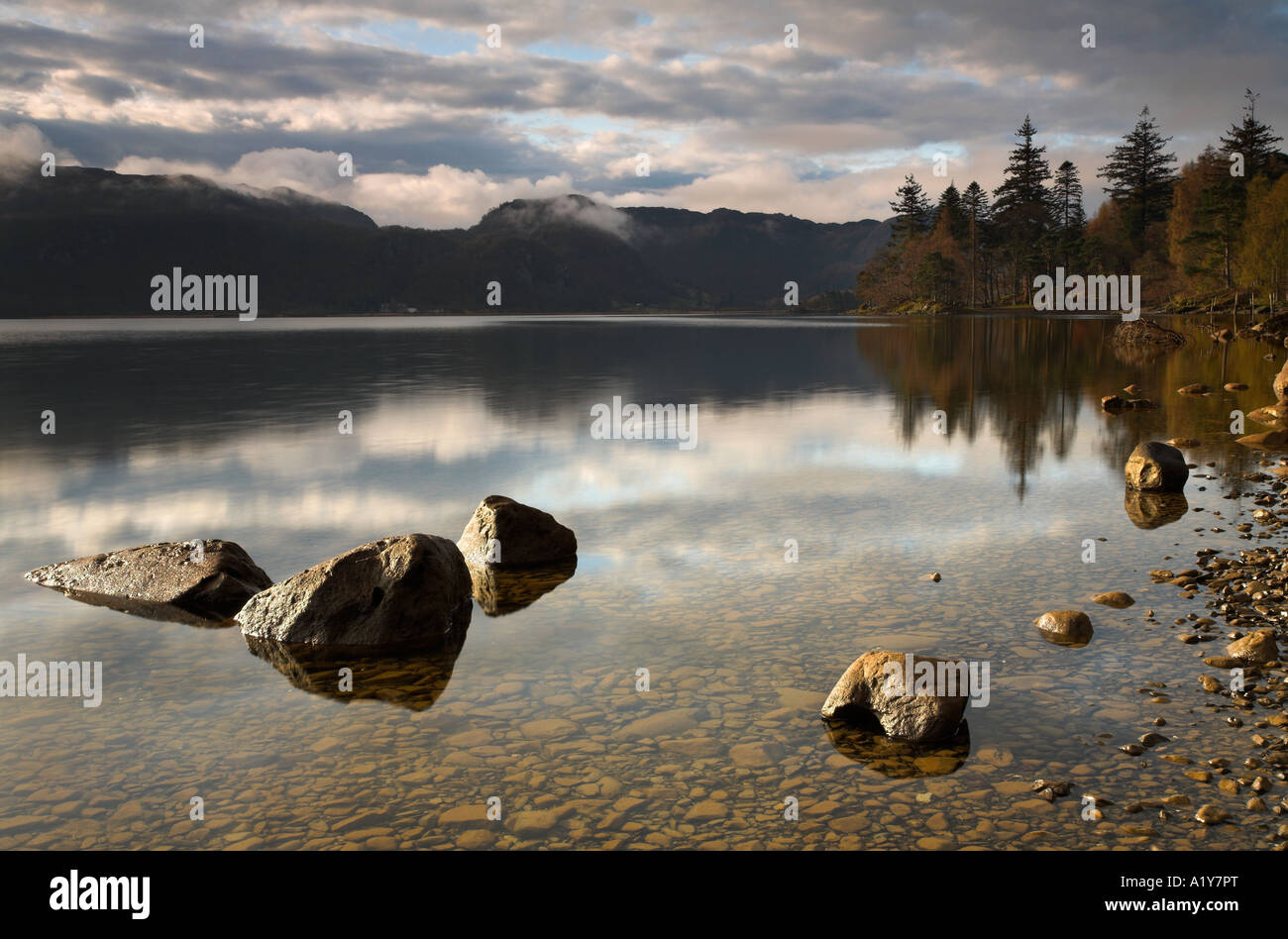 A brief glimpse of morning sunlight at Derwent Water, Lake District, England - Stock Image
