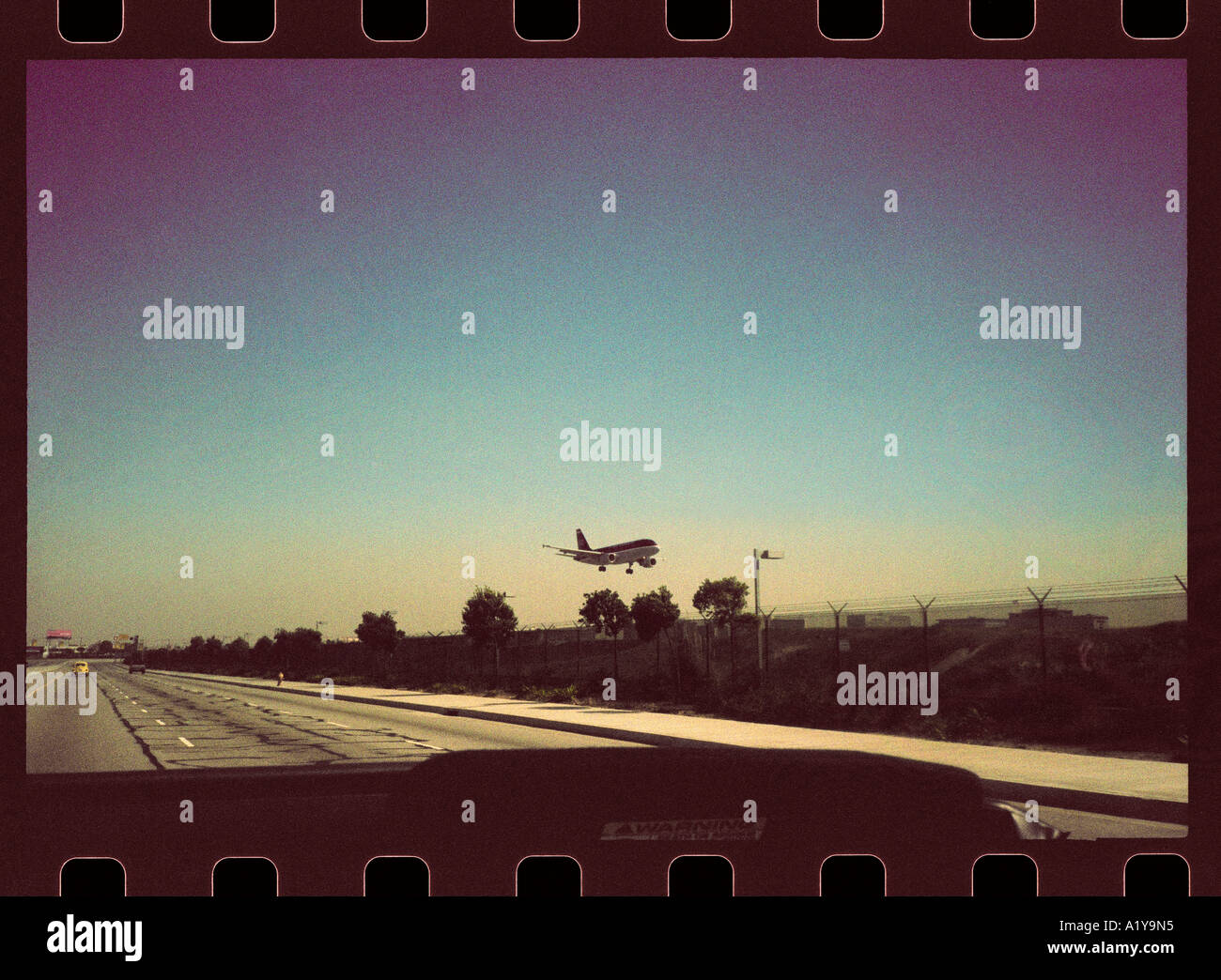 'Transit', JFK airport, New York State. Atmospheric 35mm snap image with considerable visible film-grain. - Stock Image