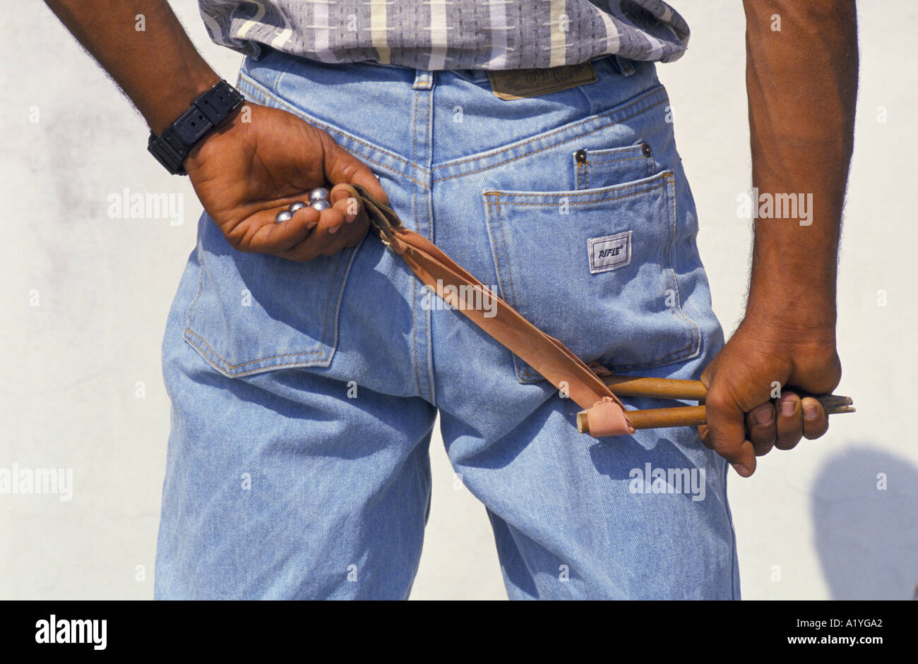 PALESTINIAN HOLDING CATAPULT DURING INTIFADA GAZA 1992 - Stock Image