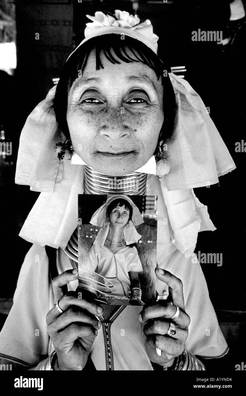 Portrait of Ma Nun a long necked woman holding a postcard with a photograph of her. - Stock Image