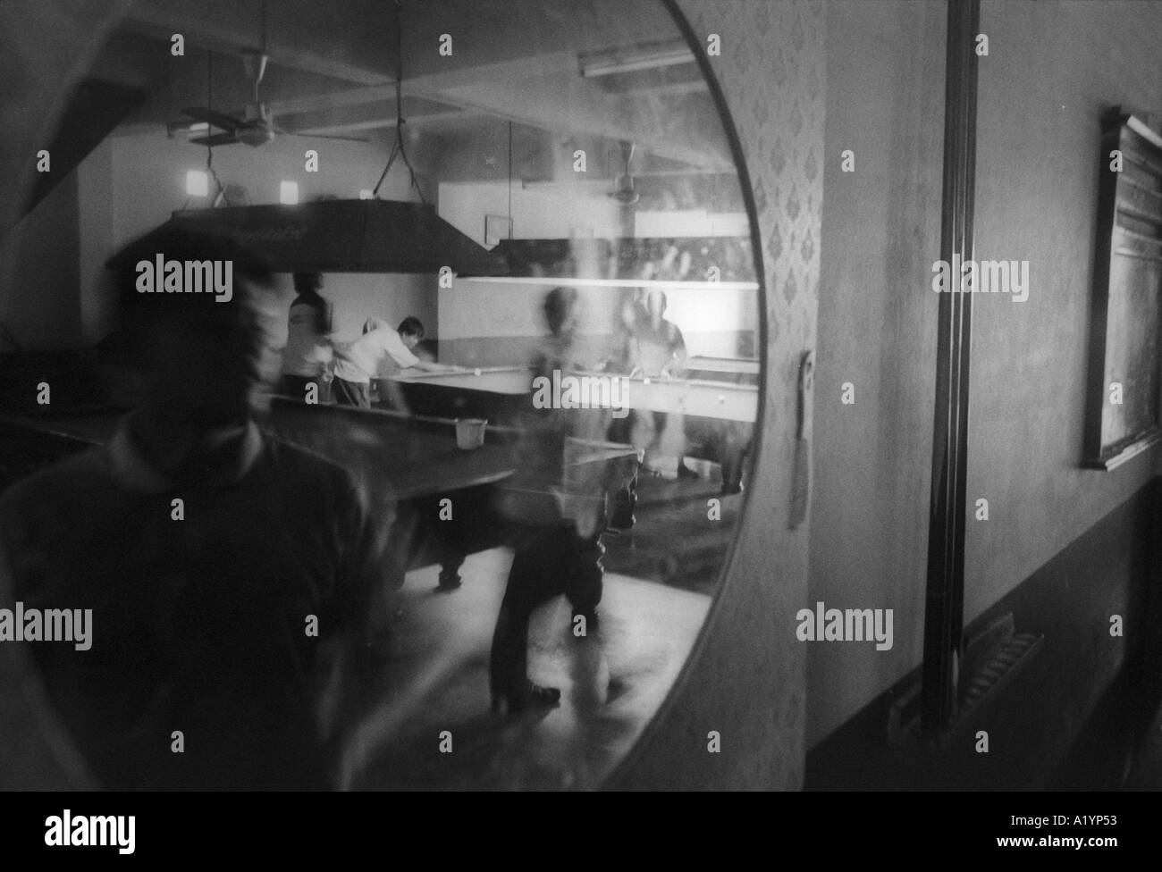 Burmese and ethnic workers play pool in Ranong Thailand Ranong is a infamous port town and a known entry for drugs being traffic - Stock Image