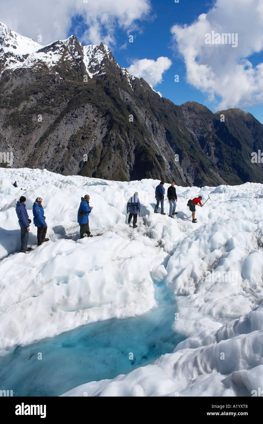 Heli hikers Franz Josef Glacier West Coast South Island New Zealand - Stock Image