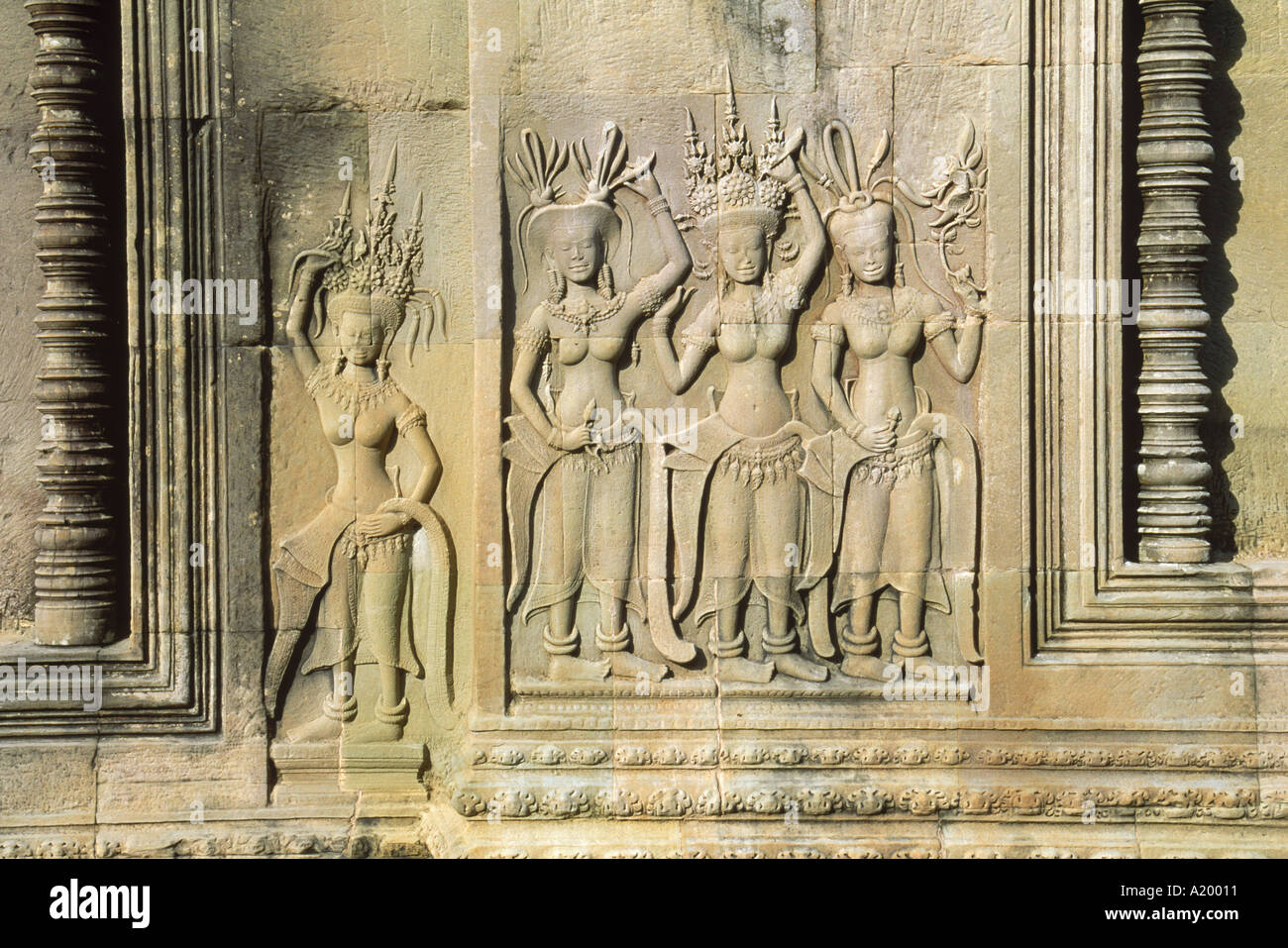 Stone bas reliefs depicting scenes of rural life and historical events on the walls of Angkor Wat Siem Reap Cambodia Asia G - Stock Image