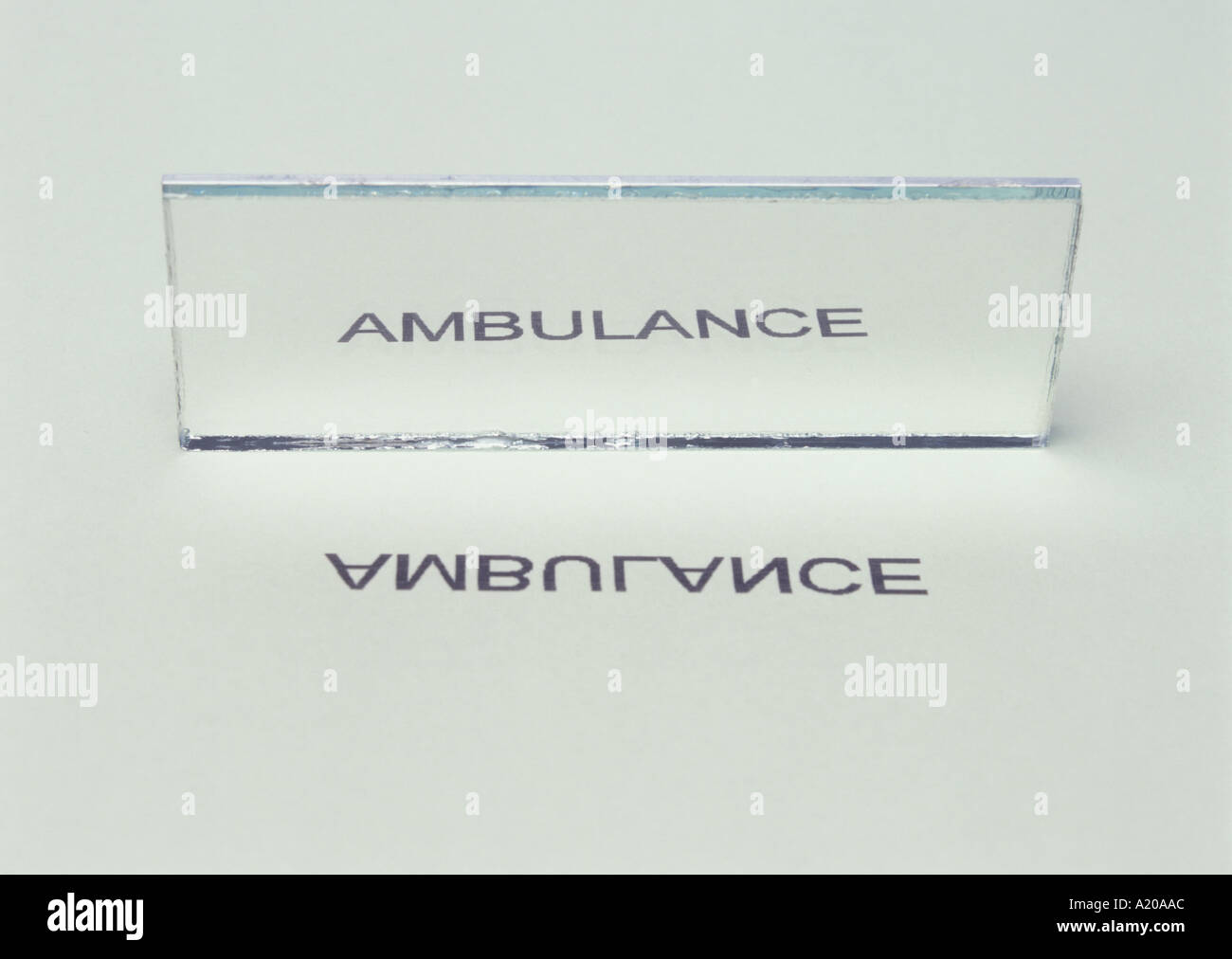 Ambulance Reflected In Mirror Shows Lateral Inversion