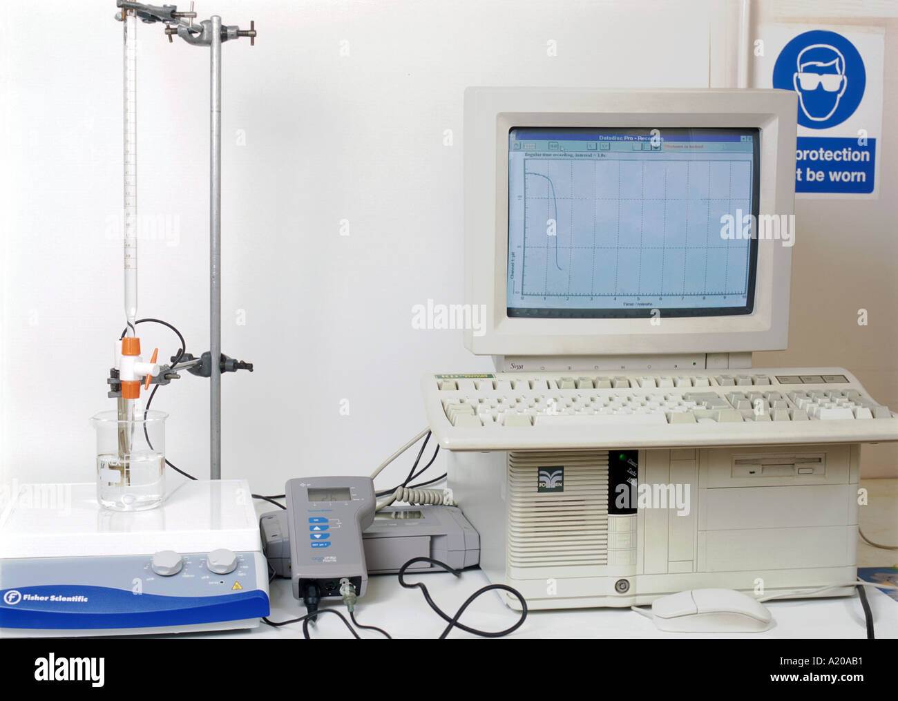 pH meter and data logger connected to a computer screen shows pH - Stock Image