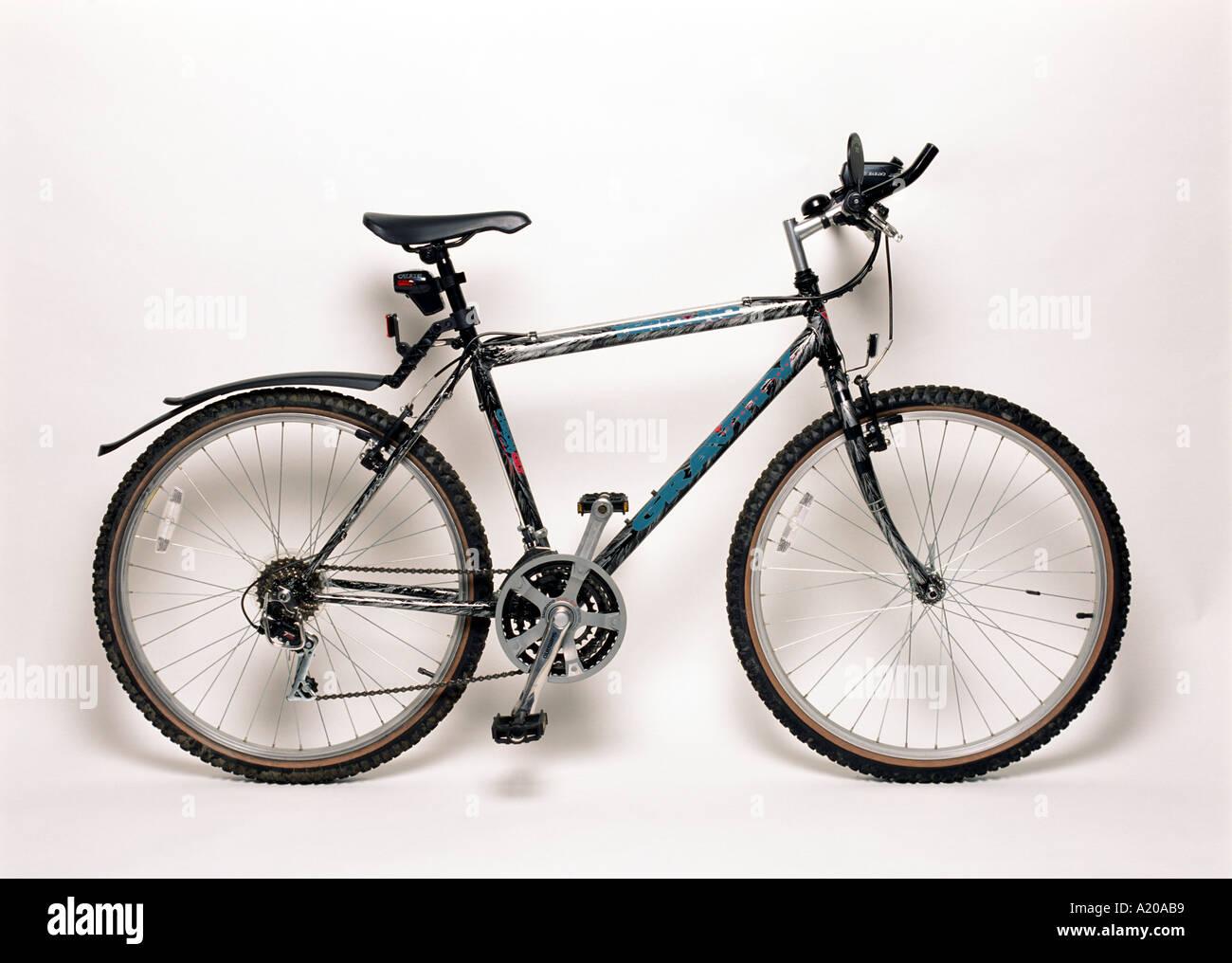 a mountain bike against plain white background - Stock Image