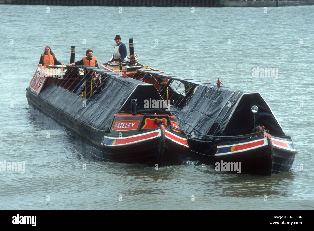 Coal carrying Josher narrowboats on the River Thames at Surrey Docks London England UK - Stock Image