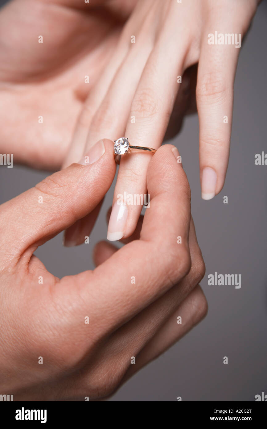 Man Placing Engagement Ring On Stock Photos & Man Placing Engagement ...