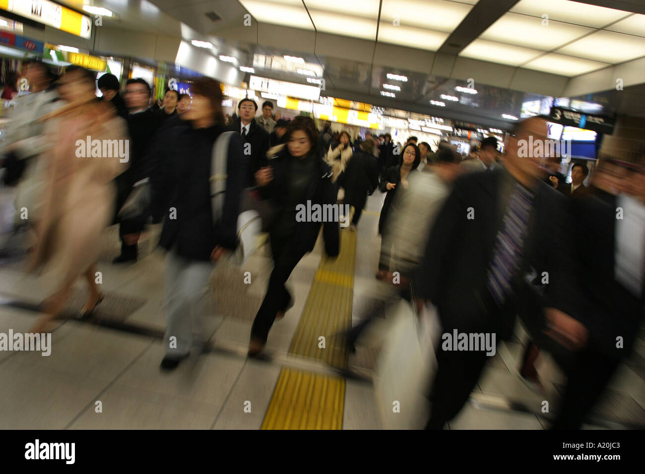 Morning rush hour commuters make their way through Tokyo Central Train Station, Tokyo, Japan - Stock Image