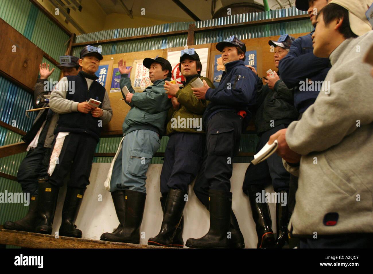 Fish buying agents bid at an auction of fresh tuna at Tsukiji fish market, the worlds largest daily fish market, - Stock Image