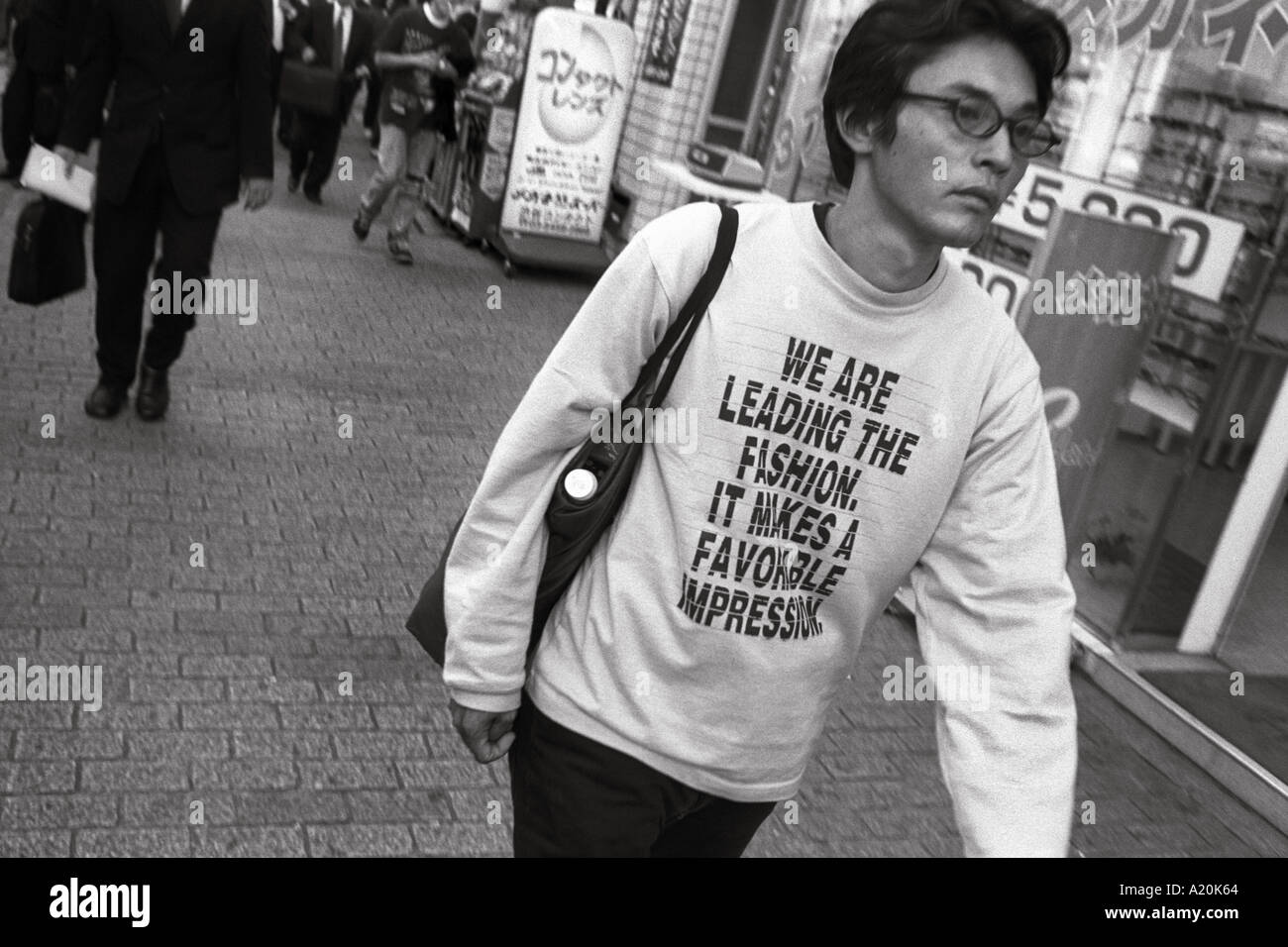 The use of English phrases and words as part of the design element on t shirts is fashionable in Tokyo, Japan - Stock Image