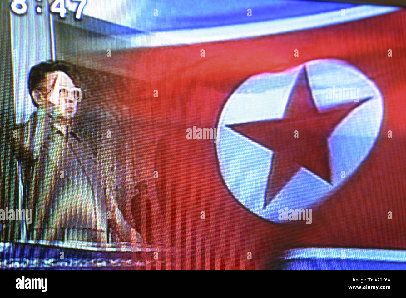 Kim Jung Il North Korean President and dictator shown in archive footage on Japanese television. - Stock Image