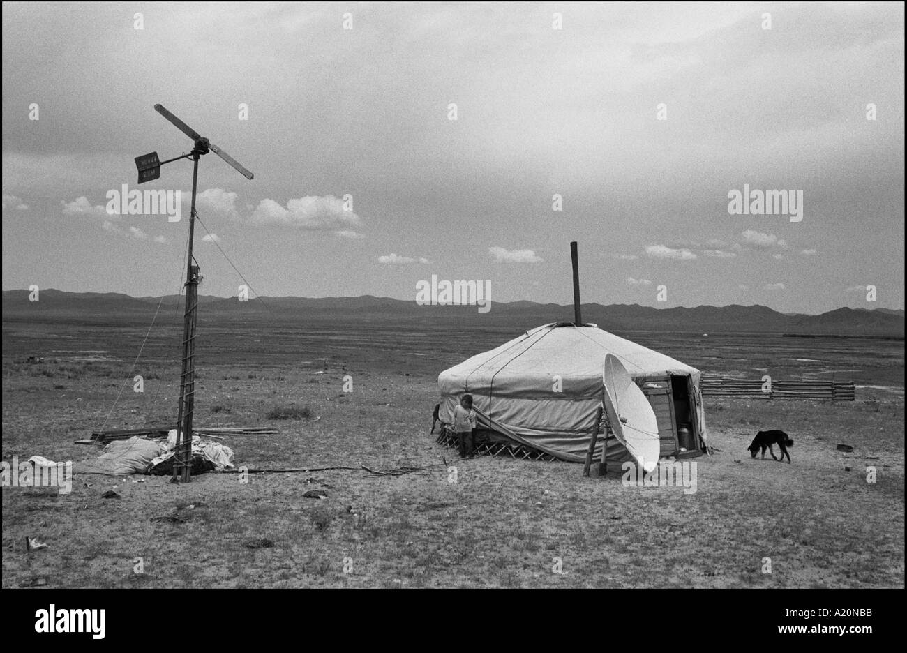 A nomads ger stands on the steppes, with their wind generator and their satellite dish, Mongolia - Stock Image