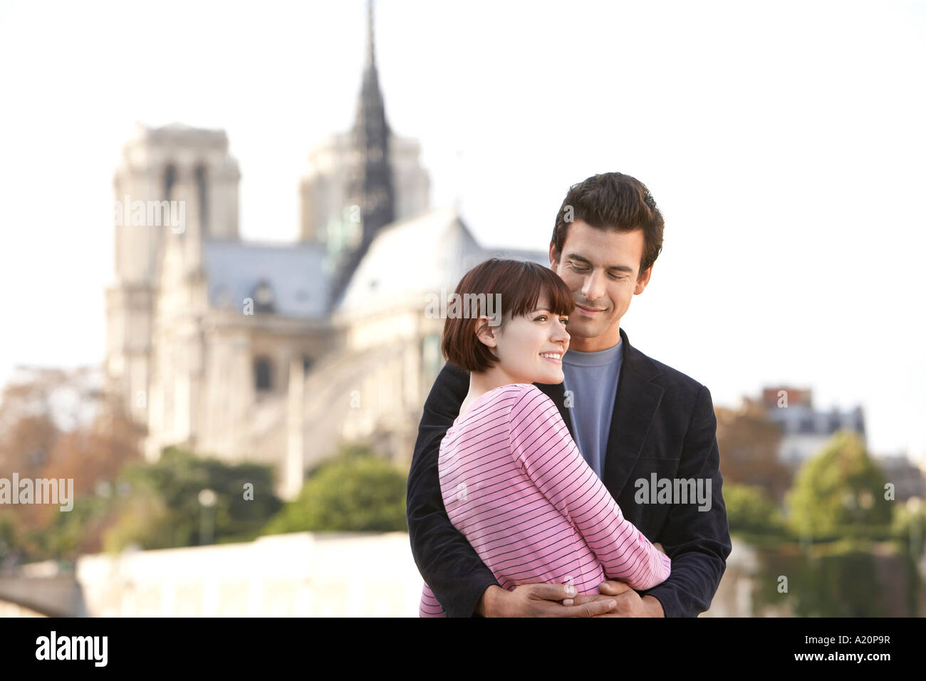 Paris, France, Couple embracing in front of Notre Dame Cathedral - Stock Image