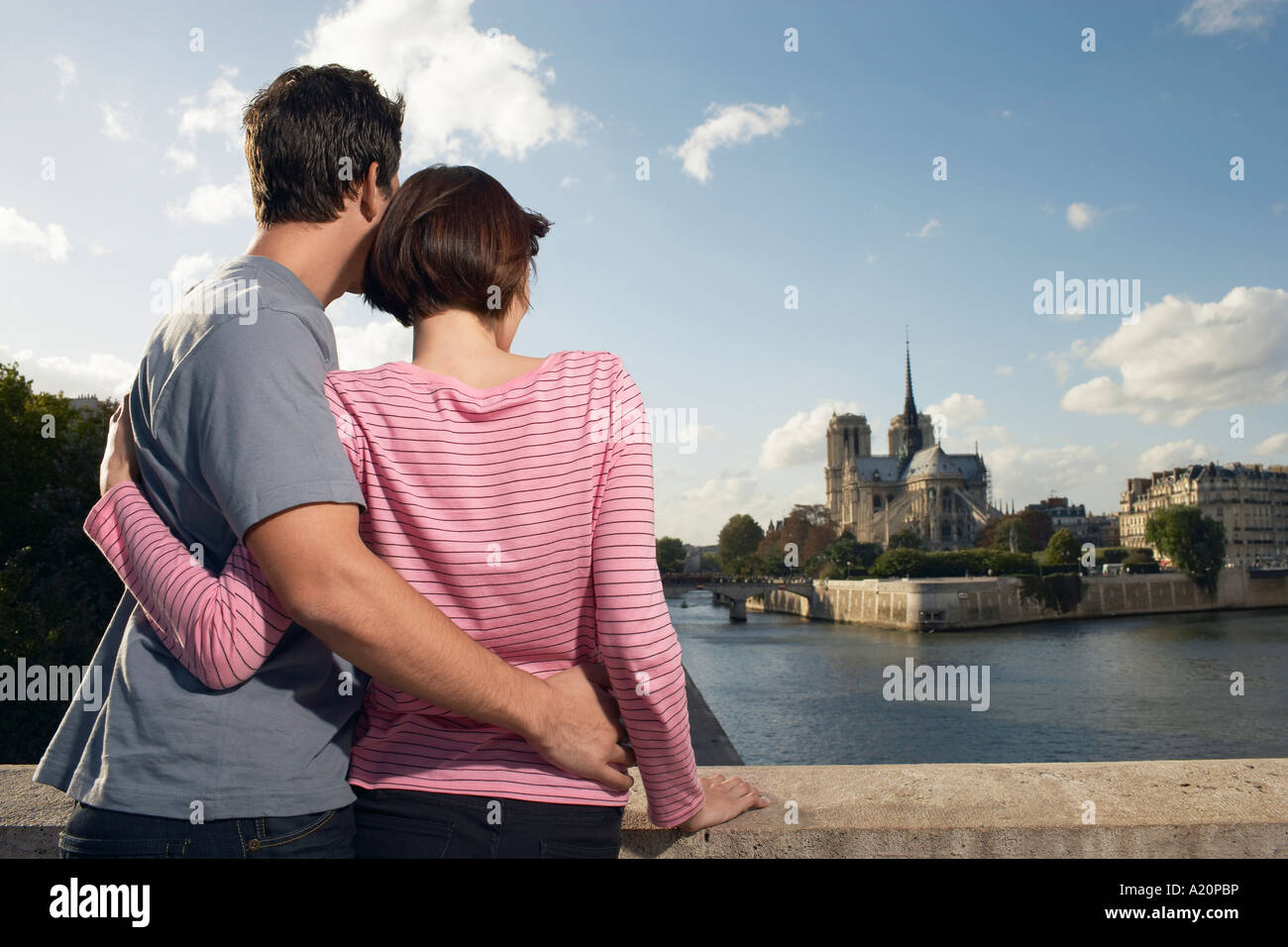 Paris, France, Couple embracing in front of Notre Dame Cathedral, back view - Stock Image