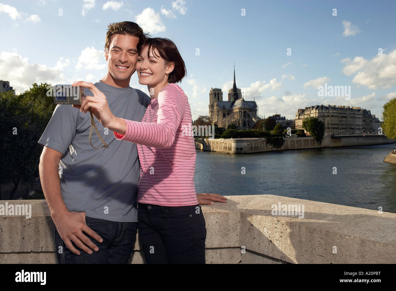 Paris, France, Couple taking a photo of themselves, in front of Notre Dame Cathedral - Stock Image