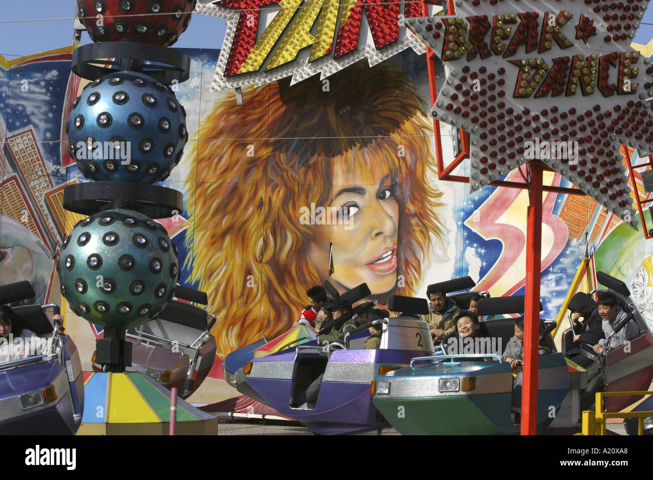 Portrait of Tina Turner at a fairground attraction, Tokyo, Japan. - Stock Image