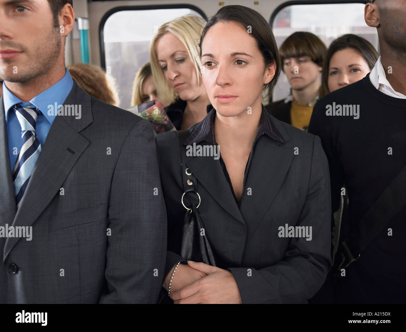 Commuters standing on a Train - Stock Image