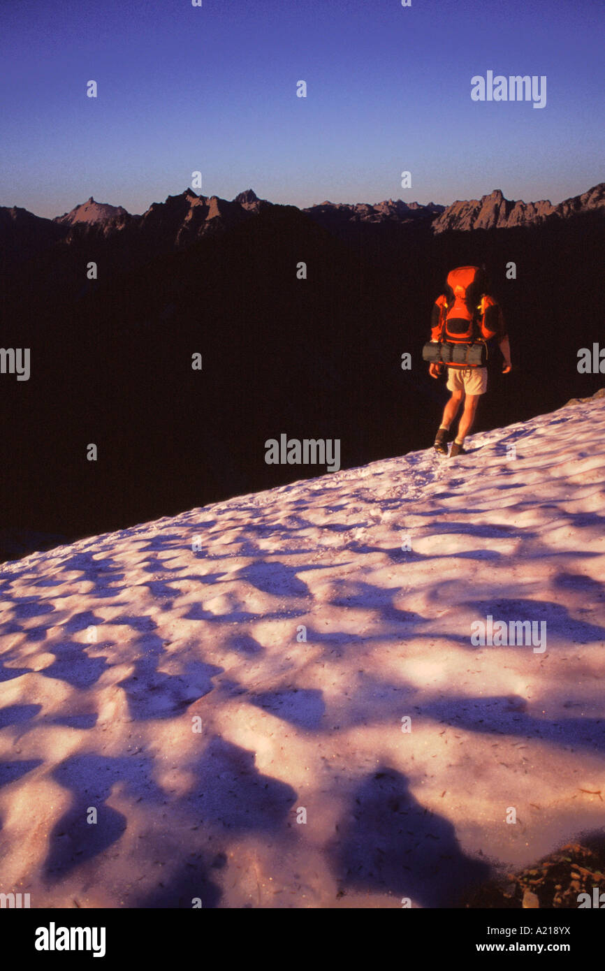 A man Hiking in snow in the Cascades Mountains in Washington - Stock Image