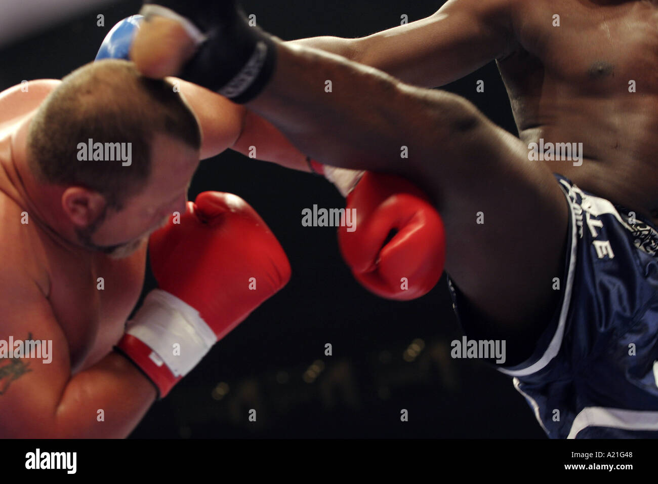 K-1 kick boxing fighters in the heat of a round, K1 tournament, Tokyo, Japan. Asia. - Stock Image