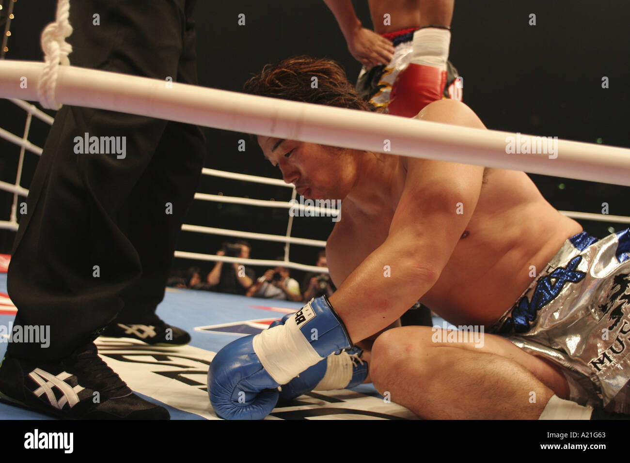 Musashi, a K1 fighter on the canvas after being knocked down, K1 World Gp 2004, Tokyo, Japan. - Stock Image