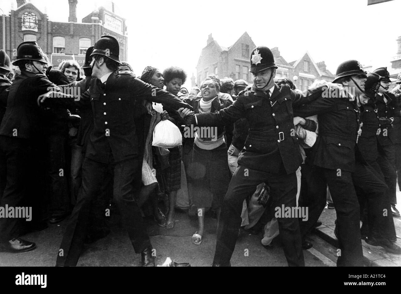 Police clashing with anti-racists protesting at the National Front marching through Lewisham area, London - Stock Image