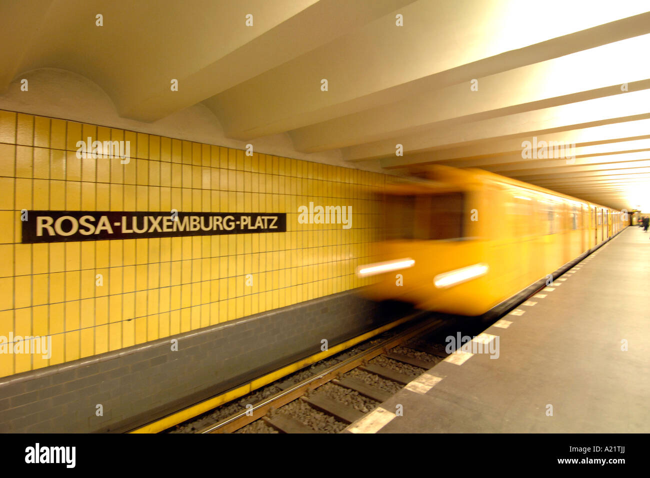 A train pulls into the platform of the Rosa Luxemburg Platz U bahn station in East Berlin. - Stock Image