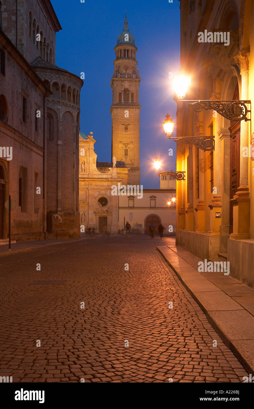 Via Cardinal Ferrari with Piazzale San Giovanni beyond at night Parma Emilia Romagna Italy NR - Stock Image