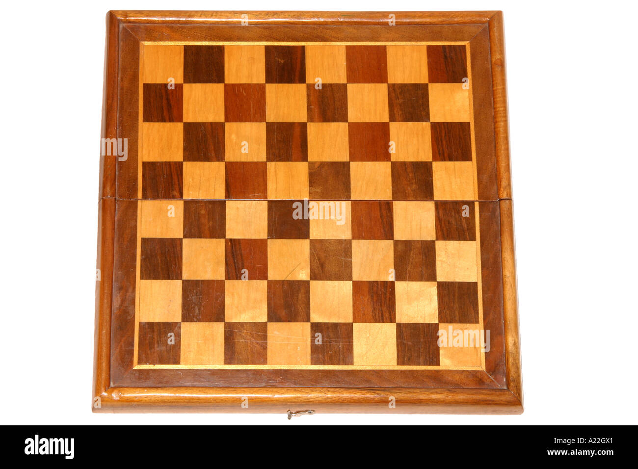 Old wooden chessboard from above - Stock Image