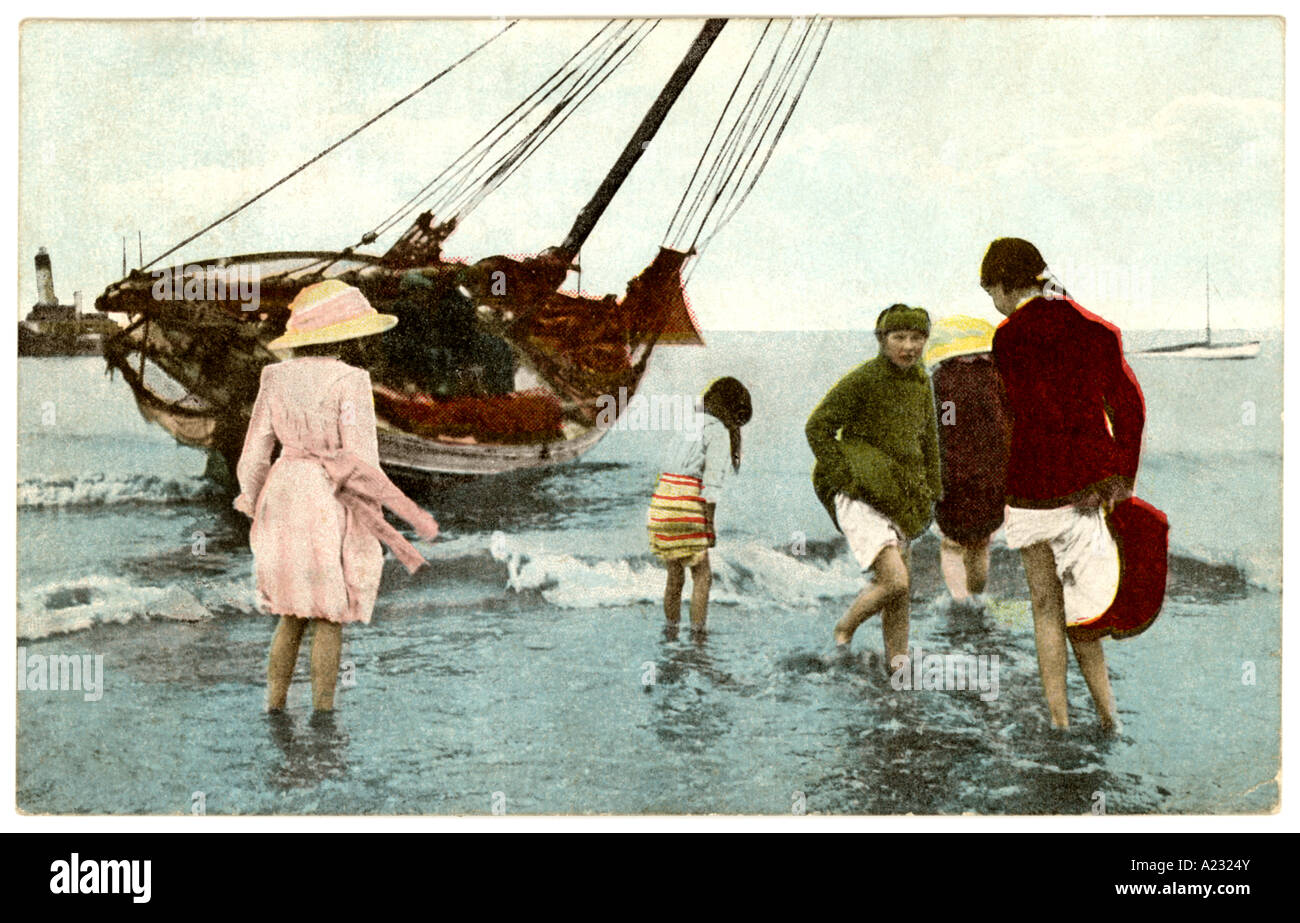 Postcard of children enjoying paddling in the sea - posted at Cleethorpes in 1919, pastimes, U.K. - Stock Image
