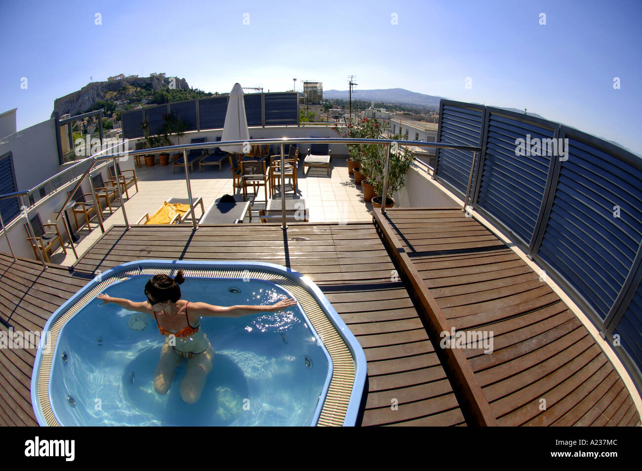 woman in jacuzzi roof rooftop hotel plaka athens greece greek capital city summer holiday vacation travel tourism lesiure freeti - Stock Image