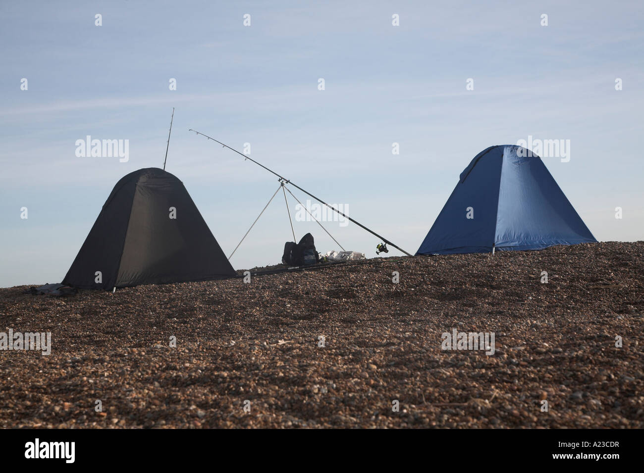 Fishing tents on the beach at Shingle Street, Suffolk, England - Stock Image
