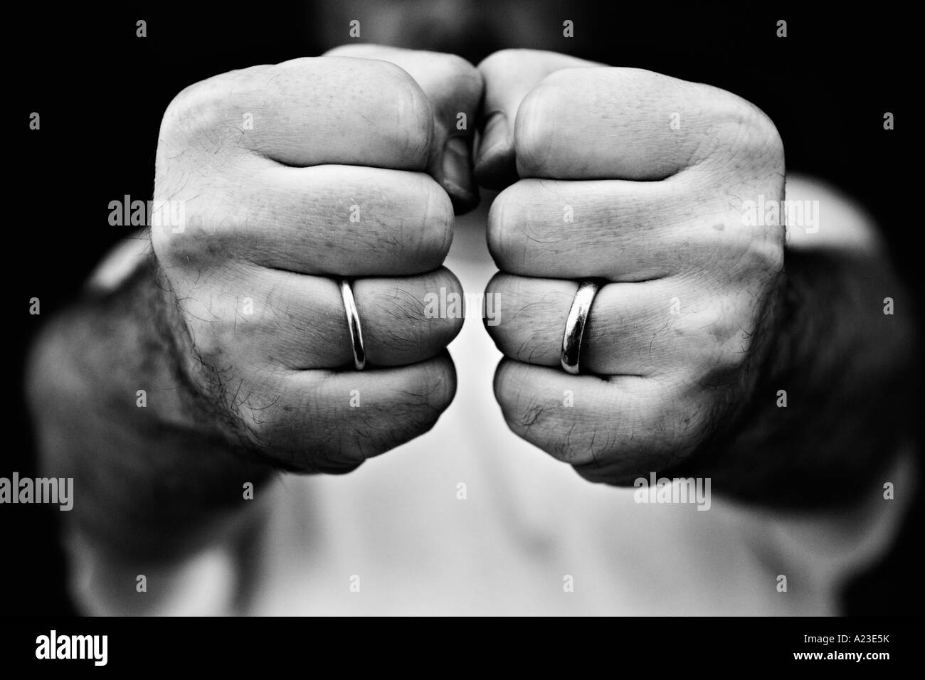 Two fists black and white close up - Stock Image