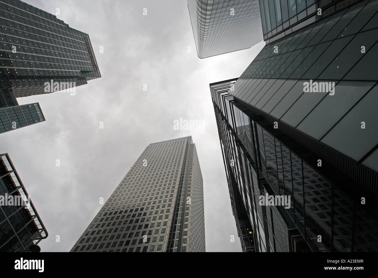 a stormy grey sky looms over large highrise office buildings in the buisness centre of the capital city London. - Stock Image