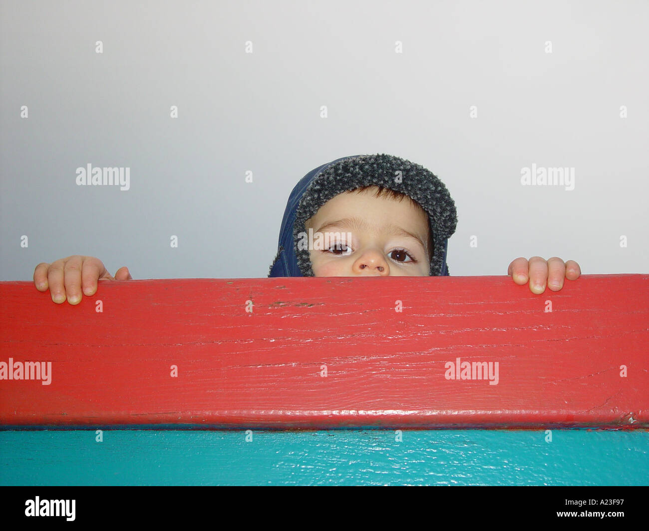 Boy looking after his mother or farther in a public nursery at the playground in afternoon Stock Photo