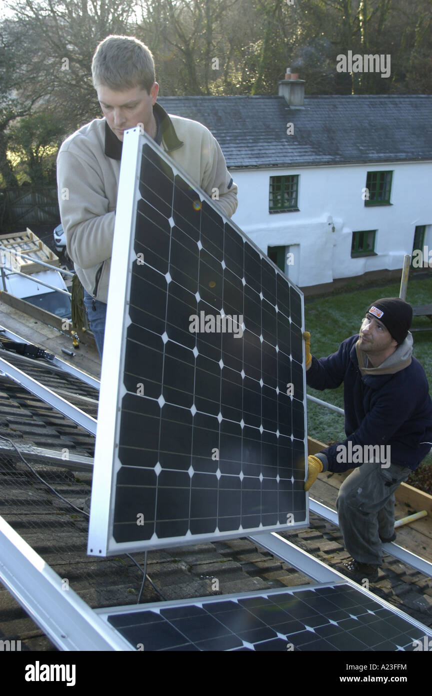 Installing photo voltaic cells on a house roof in South Devon England 5kw installed capacity - Stock Image